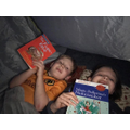 Daisy and Finn reading in their tent