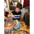 Alfie making a papier mache pig