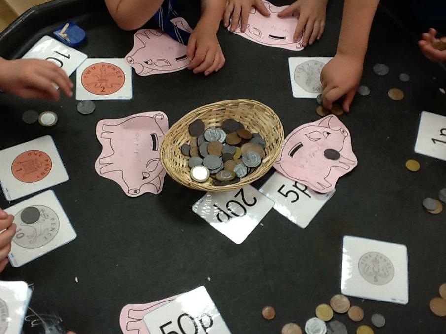 Using money to make amounts.