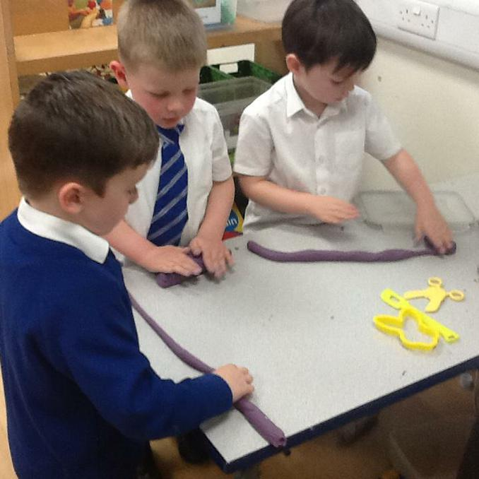 Creating different lengths in the playdough.