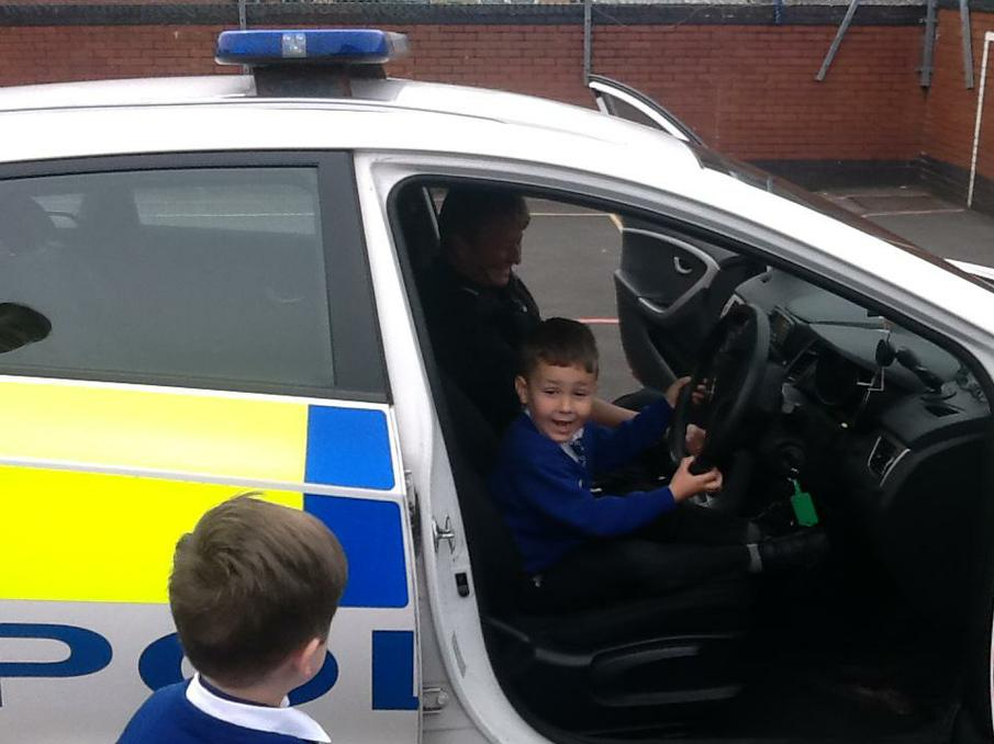 We each got to sit in a police car!