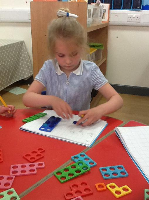 Using numicon to help with our number work.