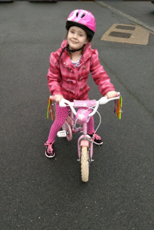 Tiffany, riding her bike without stabilizers