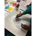 Using coloured rice to create Rangoli patterns