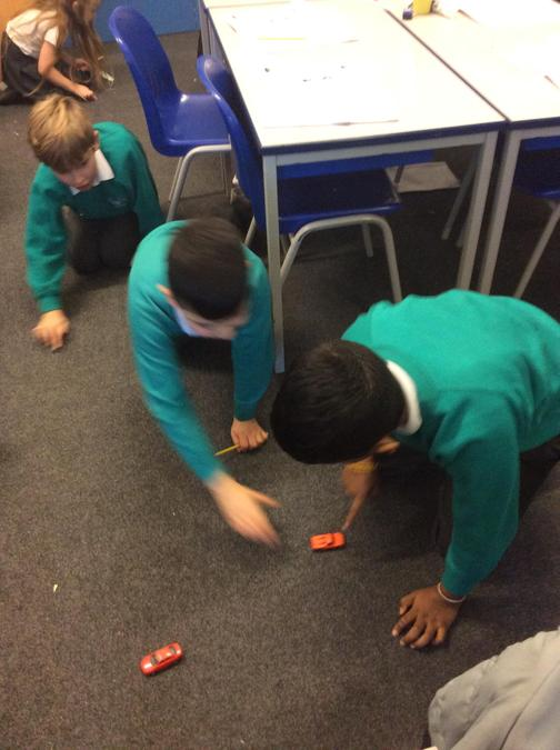 Investigating friction with toy cars