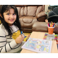 This young lady enjoys colouring, that is what makes her happy!
