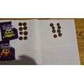 This young man has used chocolate to help him work out tens and ones.