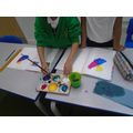 mixing the 2 primary colours to make a secondary colour