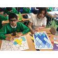 Designing prayer rugs with geometric patterns.