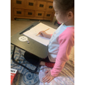 This young lady loves to draw and that makes her happy!