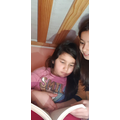 N reading to her little sister
