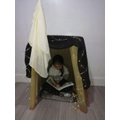 This young lady's den is SO comfy she has decided to hide away and read!