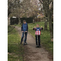 Noah and brother out for a scoot!