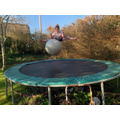 Emily on a trampoline.