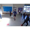 We've been practising our badminton skills in PE.