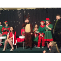 Rudolph can't get the elves to sing-a-long