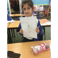 Rose is really proud of her poster all about the human skeleton!