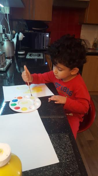 Junaid painting at home!