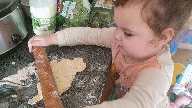 Emmie is busy making scones. Yummy!
