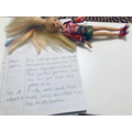 Writing about my doll using adjectives.
