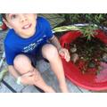 Samuel has made a home for some tadpoles