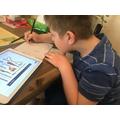 Benjamin looking at Stone Age tools