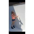 Rosie making shadow puppets.