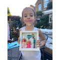 Mia made a peg picture of her family.
