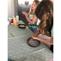 Bethan and April baking a cake.