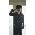 Dressed as a pilot.