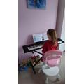 Jasmine has been practising her piano