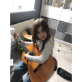 Skye playing guitar