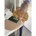 Holly doing scratch art