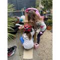 Lola and Mia making a cardboard rocket