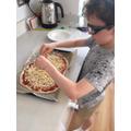 Benjamin making pizza