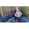 Benjamin and his brother trampolining.