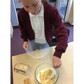 Adding the cake crumbs