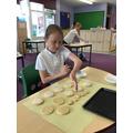 Olivia icing her biscuits.