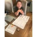 Benjamin doing maths.