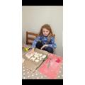 Rosie making salt dough art.