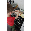 Josh making pizza.