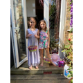 Lola and Mia completing their Easter egg hunt