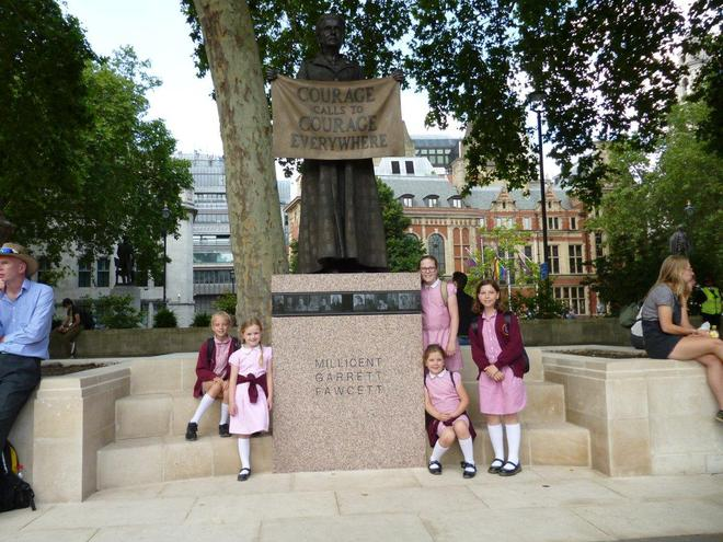 St Mary's pupils view the new Millicent Fawcett memorial before they enter Parliament
