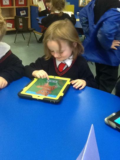 We use Ipads to help us learn. Beatrice spelt CAT