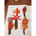 We made autumn leaf prints in science.