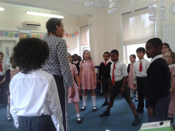 Warming up for a drama lesson in Arts Week