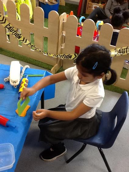 Our fingers grow stronger when we play with playdough!