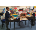 Key Stage 1 children helping to pack bags of food gifts to take to the Foodbank.