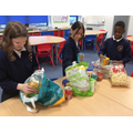 Key Stage 2 children are also busy in sorting and packing food.