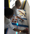 The boys are working hard to sort all of the pictures - great team work.